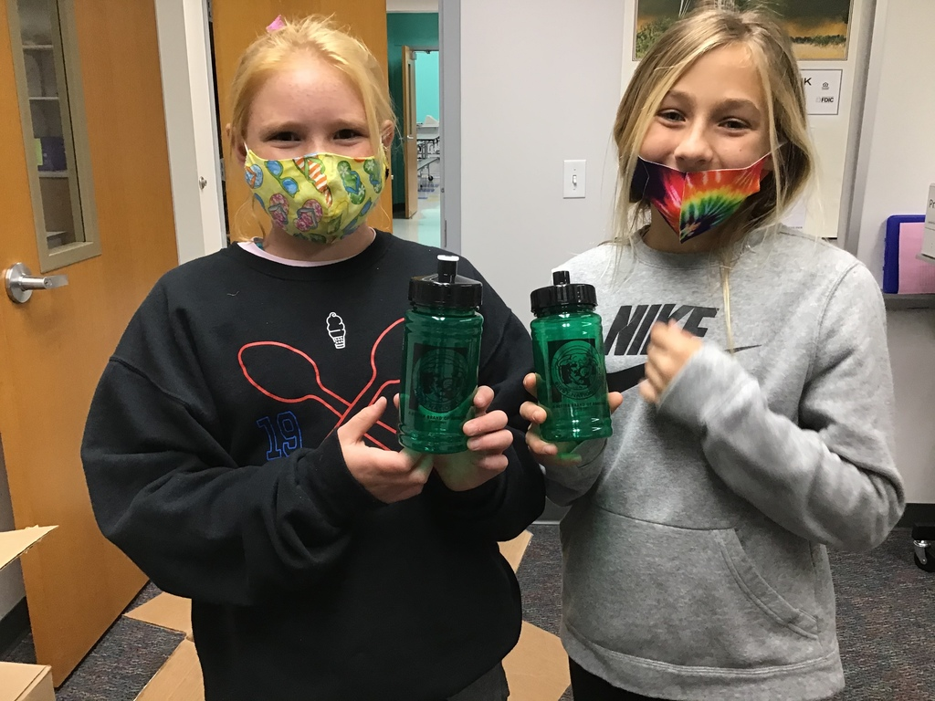 Elementary students with water bottles